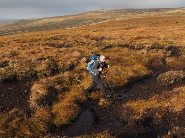 Paul navigating his way across the peaty terrain of James's Hill