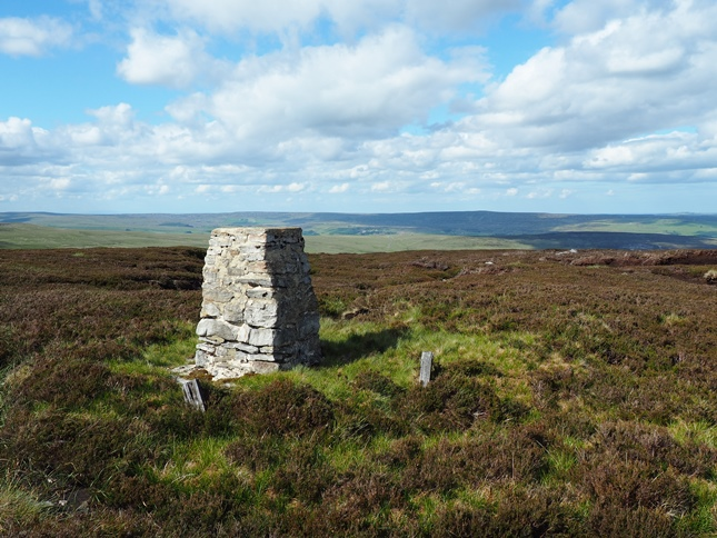 The Ravens Seat trig point on Harnisha Hill looking towards the moors on the other side of Weardale