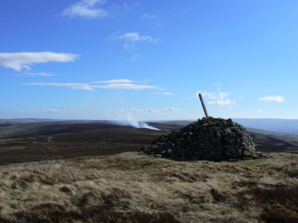 The currick on Killhope Law - note the heather burning in the background