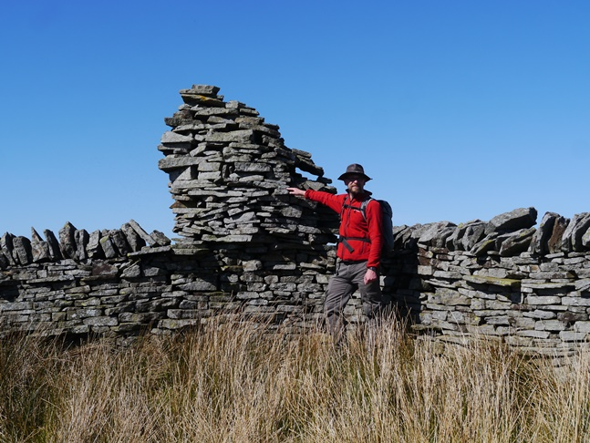 By the precariously balanced cairn on Kip Law