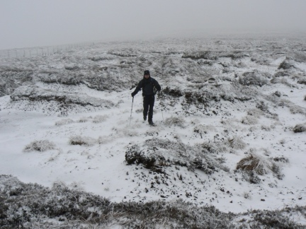 Matt negotiating the frozen peat hags on the way to Black Fell