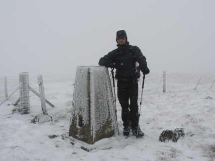 Matt by the trig point on Black Fell