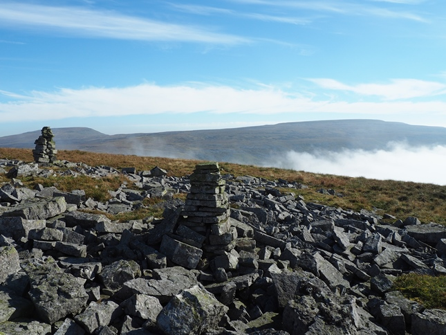 A pair of curricks with views across the top of Scordale towards Mickle Fell and Little Fell