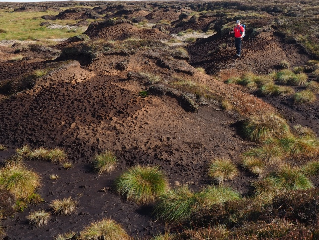 Paul crossing a substantial area of peat hags and groughs