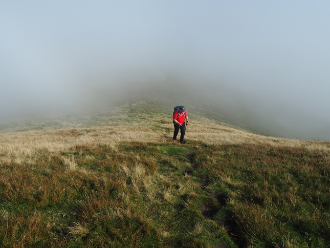 Paul on the steep final climb to the top of Murton Pike