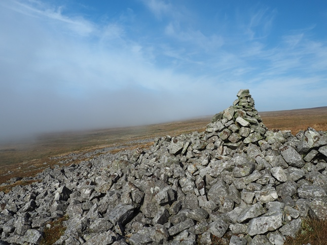 Emerging back out of the cloud at the currick on North Edge