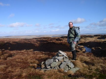 By the summit cairn of Chapelfell Top