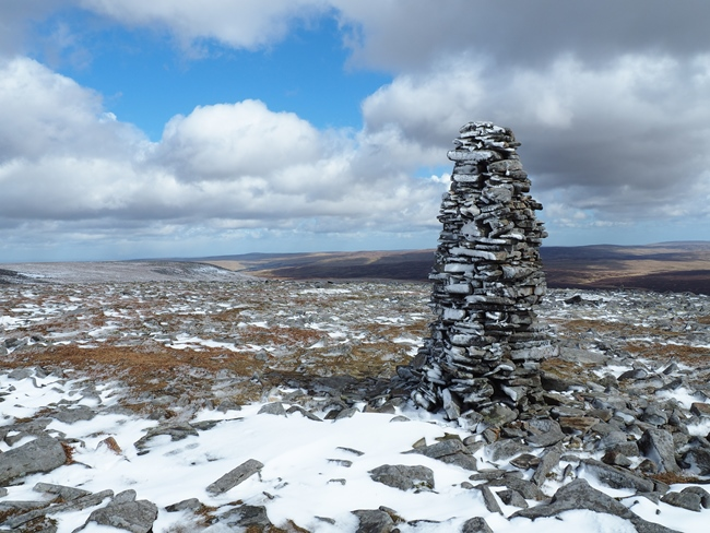 The impressive 8ft high cairn alongside the Pennine Way above the escarpment