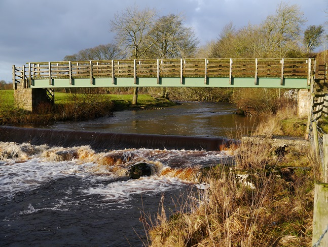 The footbridge carrying the Pennine Way over the River Greta
