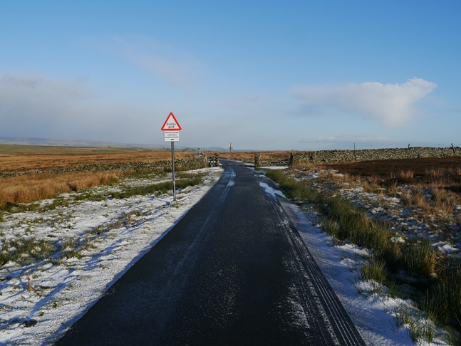The quiet road that runs across the moor from Gilmonby to Sleightholme Farm