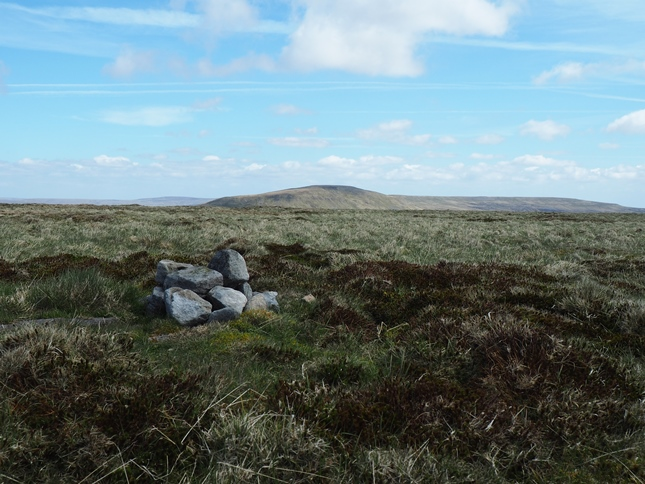 The small pile of stones marking the summit of Little Fell