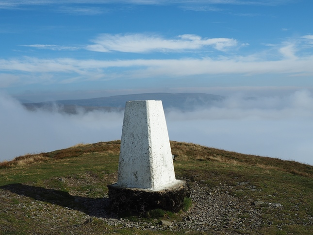 The trig point on the summit of Murton Pike