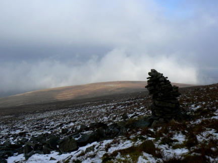 The leaning cairn below the summit looking towards Bruthwaite
