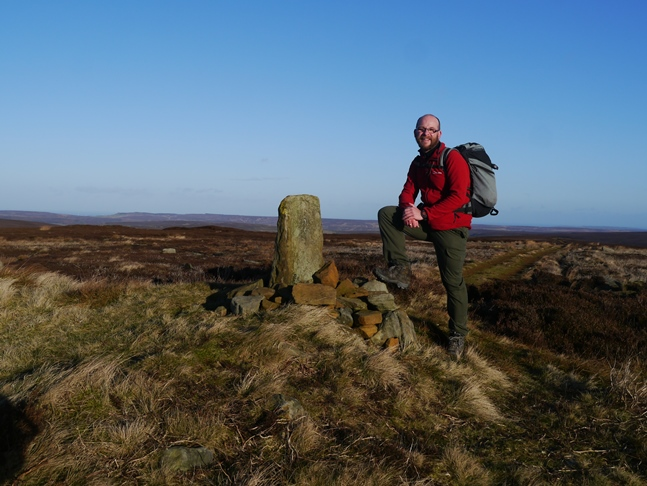 By the boundary stone and tumulus on Burton Howe