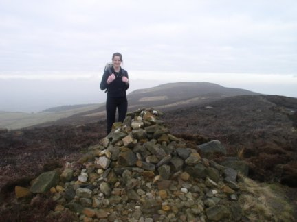 Lisa by one of the cairns on Cold Moor