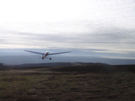 A glider takes off on Carlton Moor