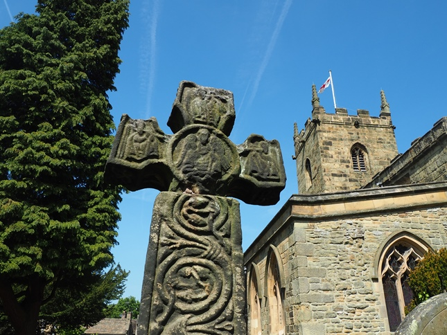 The 8th century Celtic cross in the churchyard at Eyam