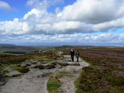Lisa and Mandy walking along Stanage Edge