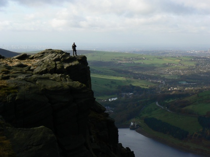 Matt on Dovestones with the sprawl of Greater Manchester on the horizon