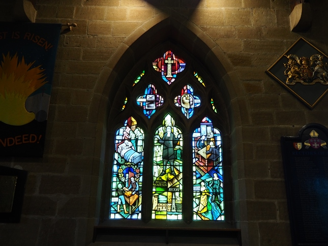 The 'Plague Window' in Eyam's church depicting scenes from the plague
