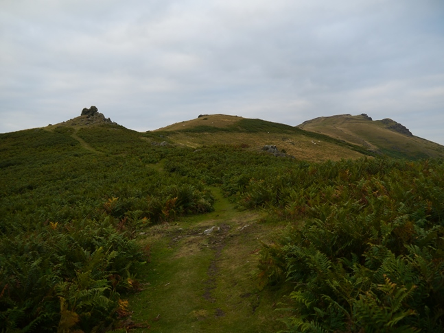 Looking back up at Three Fingers Rock on the left and Caer Caradoc on the right