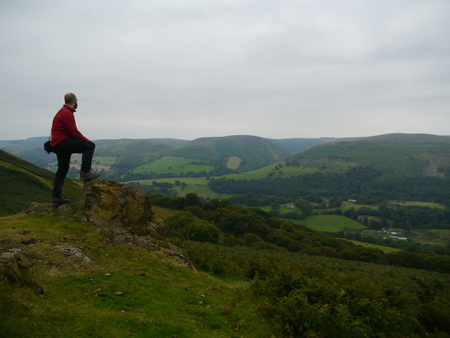 Enjoying the view of the Long Mynd from a small outcrop of rock