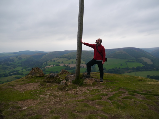 By the large pole on Ragleth Hill's south top