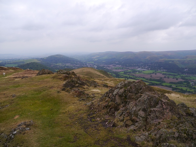 The top of Caer Caradoc looking towards Church Stretton and The Long Mynd