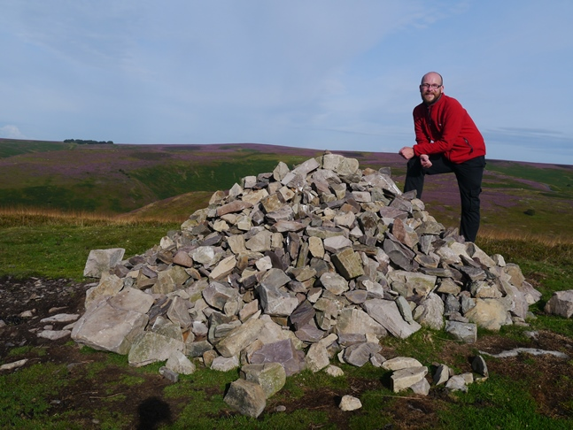 By the large cairn marking the summit of Yearlet