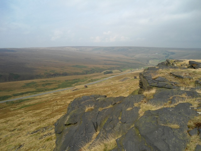 Looking down on the A62 from the gritstone edge on Pule Hill