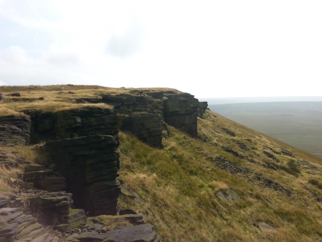 Looking back up the gritstone edge to the top of Pule Hill