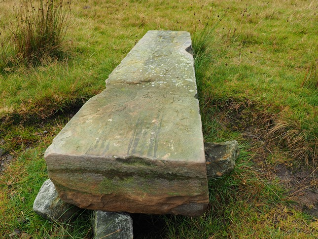 The tall boundary stone near the summit has unfortunately toppled over