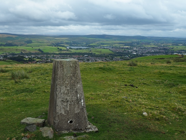The trig point on East Hill looking to Littleborough and Hollingworth Lake