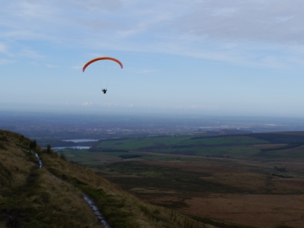 A paraglider above Winter Hill