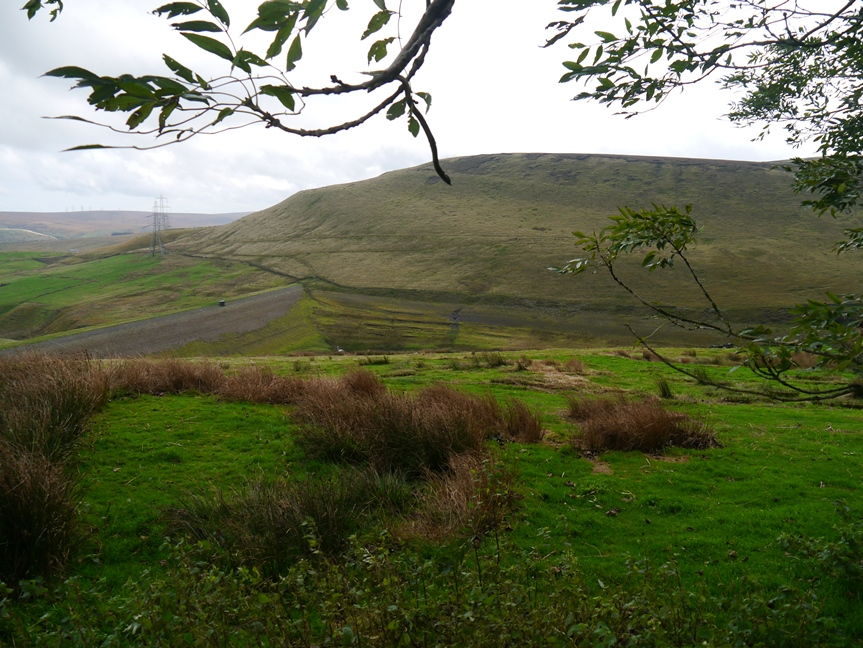 Looking down to the empty Ramsden Clough Reservoir