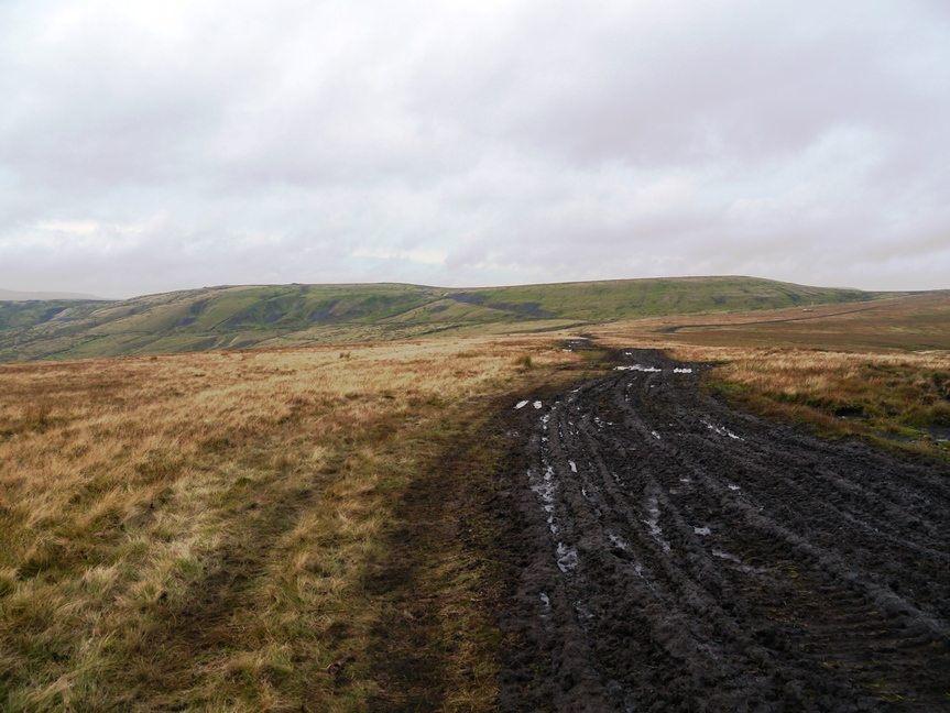 The dark muddy smear of a path leading towards Rough Hill