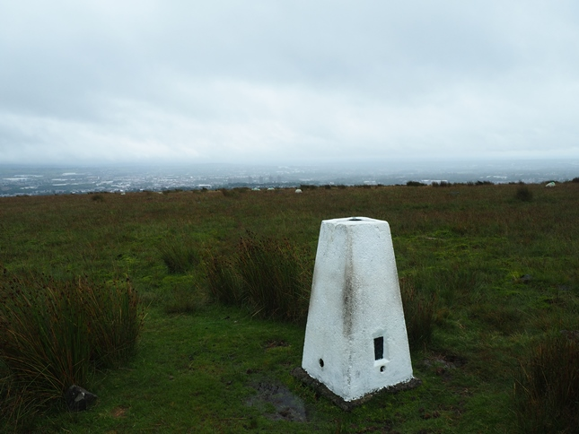 The Healey trig point on Rushy Hill looking south to Rochdale