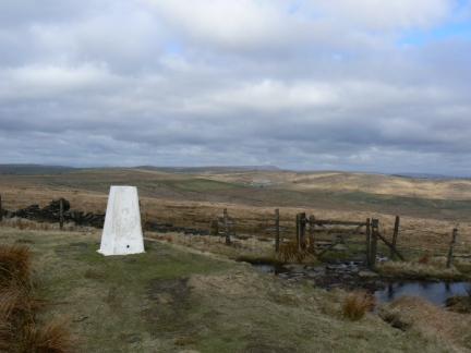 The trig point on the summit of Freeholds Top