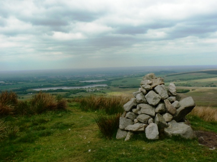 The cairn marking the Bronze Age burial mound on Noon Hill