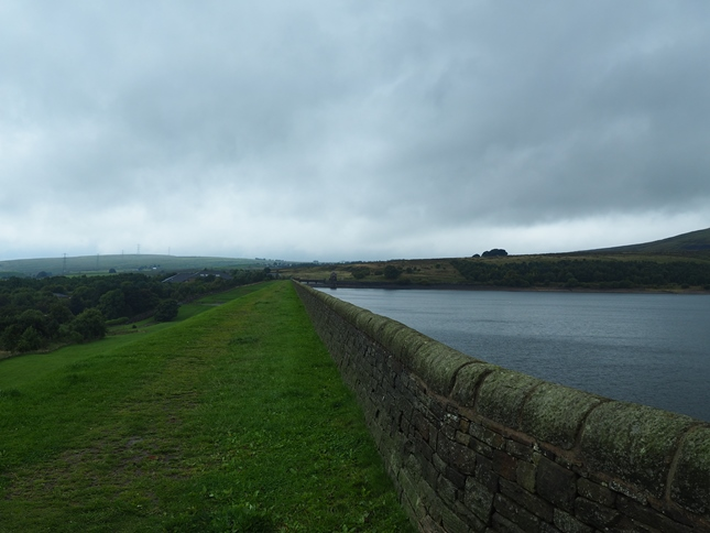 Looking along the dam with our first objective, Rushy Hill, in the distance on the left